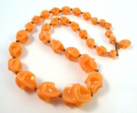 Vintage Sculptered Peach Lucite Bead Adjustable Length Necklace.
